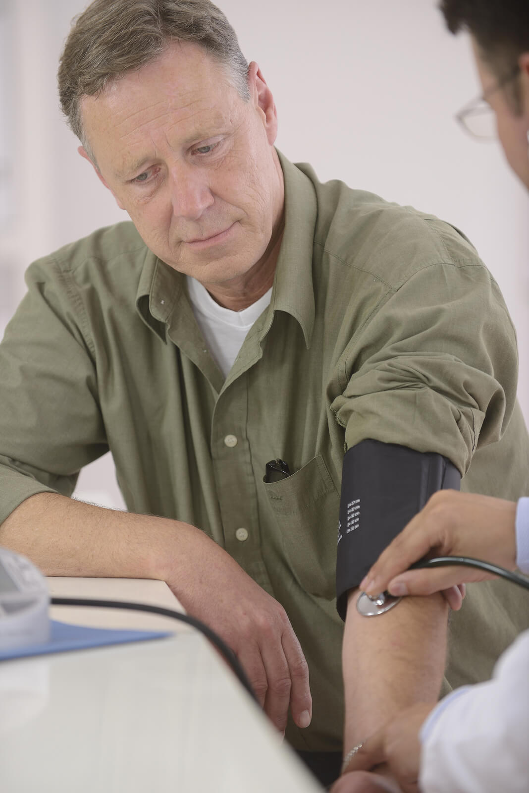 Man taking a Blood Pressure test